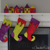 A Set of Jester Stockings and Holiday Row Houses