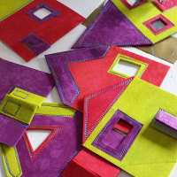 Studio Snapshot | A Set of Jester Stockings and Holiday Row Houses